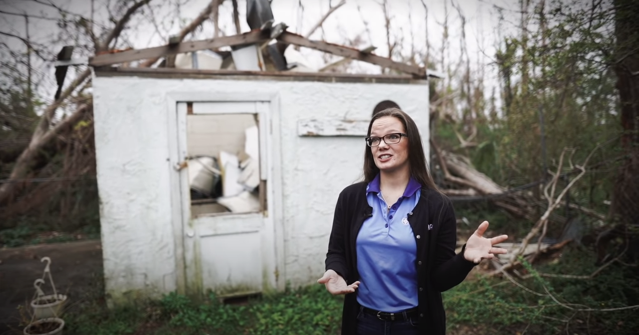 Wewa Films | Woman speaks in front of a building destroyed by Hurricane Michael