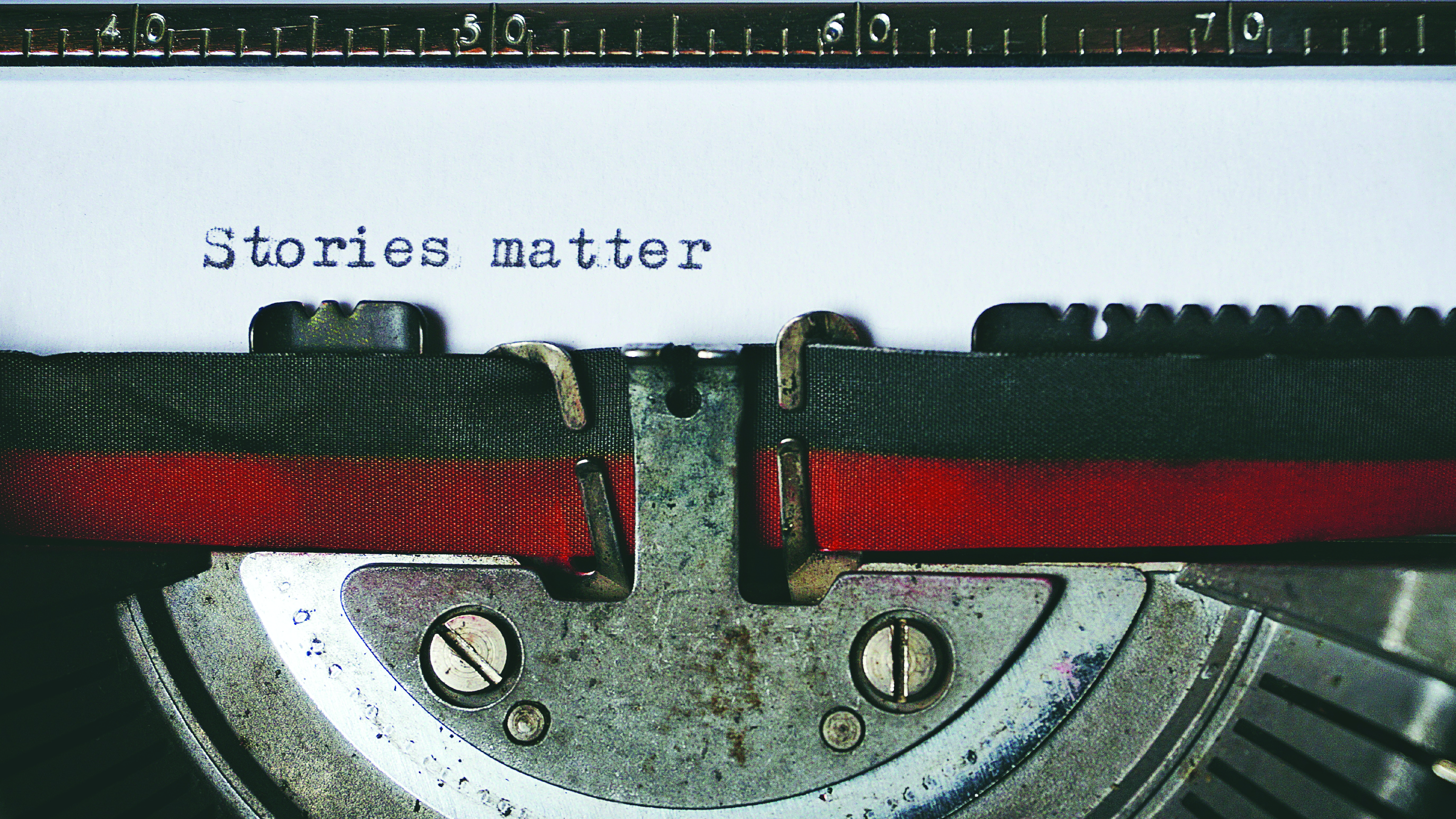 "Wewa Films | Old fashioned typewriter with ""Stories matter"" typed out"